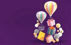 气球礼品盒和购物袋被紫色背景上五颜六色的球包围。