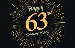 63周年快乐。带有烟火和黑色背景的庆祝标志